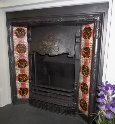 Britain`s Heritage Art Nouveau tiled fireplace