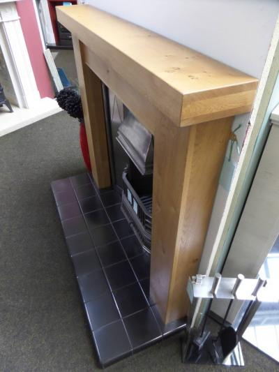 oak mantel surro8nd fireplace