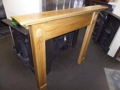 britain`s heritage pine wood fireplace surround